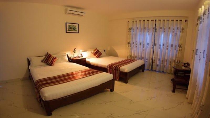 Không gian phòng ngủ ở Hotel Nam ViệtVũng Tàu