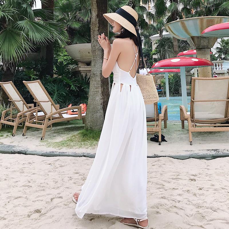 Đầm maxi hở lưng dây đan màu trắng