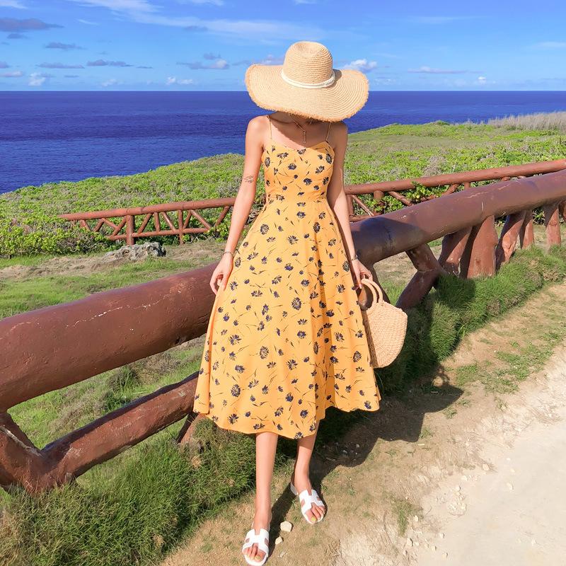 Đầm maxi đi biển màu vàng họa tiết hoa